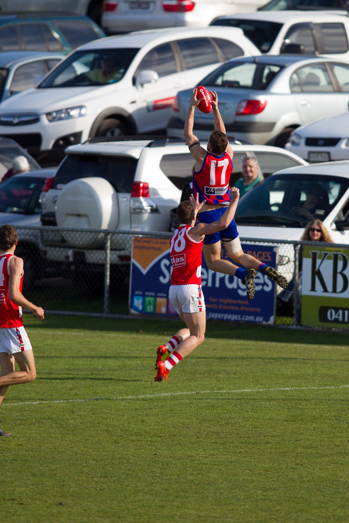 Jye Lloyd (Rye Football Club) flies high over his Sorrento opponent. RJ Rowley Reserve, Rye. 23 August 2014.